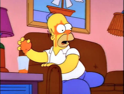 Homer Simpson making OJ the old fashioned way